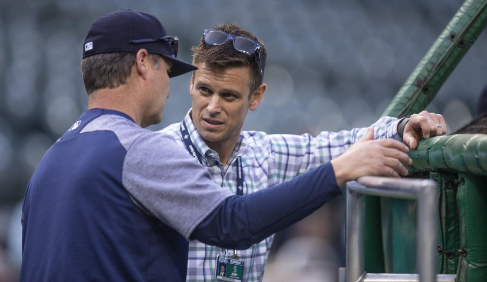 A fired Mariners employee accused GM Jerry Dipoto, right, and manager Scott Servais of making racist statements about Latino players. (Getty)