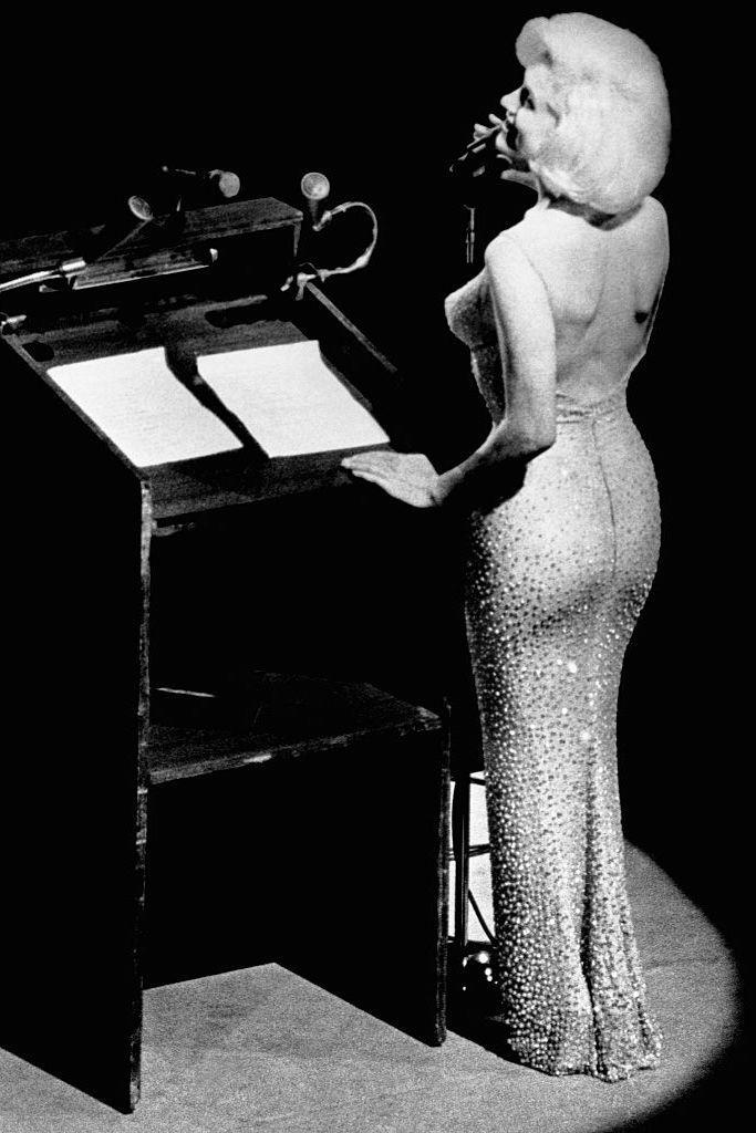 """<p>In 1961, this gown was designed by Jean-Louis Berthaulto specifically for Monroe's Madison Square Garden performance of """"Happy Birthday, Mr. President"""" at John F. Kennedy's 45th birthday party. According to <a href=""""http://www.topteny.com/top-10-most-expensive-dresses-in-the-world/"""" rel=""""nofollow noopener"""" target=""""_blank"""" data-ylk=""""slk:TopTeny.com"""" class=""""link rapid-noclick-resp"""">TopTeny.com</a>, the pink sequins gown was sold at an auction for $1.3 million big ones. </p>"""