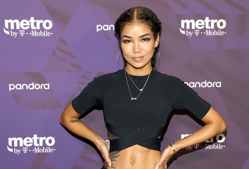 Jhene Aiko in attendance at the Metro by T.Mobile event in a black outfit revealing her amazing abs