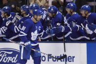 Toronto Maple Leafs center John Tavares (91) celebrates his goal against the Tampa Bay Lightning during the first period of an NHL hockey game Thursday, Oct. 10, 2019, in Toronto. (Cole Burston/The Canadian Press via AP)