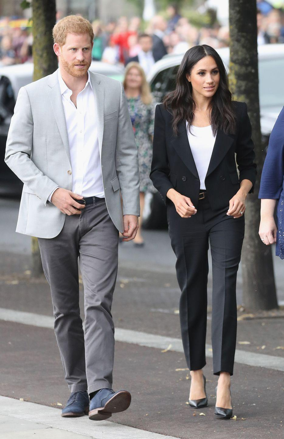 <p>The Californian beauty changed into a bespoke fitted black suit and white tee by Givenchy during her trip to Ireland. She coordinated the outfit with a gold buckle Givenchy belt, as well as carrying a £1,690 Givenchy clutch bag and a pair of black Sarah Flint stilettos. </p>