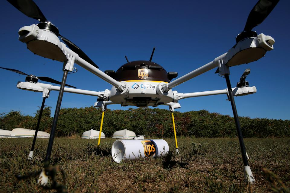 A drone, made by CyPhy Works, stands over the UPS package it carried to Children's Island off the coast of Beverly, Massachusetts, U.S. September 22, 2016, during UPS's demonstration of a drone making a commercial delivery of a package to a remote or difficult-to-access location. Picture taken September 22, 2016. REUTERS/Brian Snyder