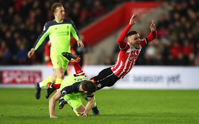<p>Dusan Tadic goes to ground under James Milner's tackle (Getty Images) </p>