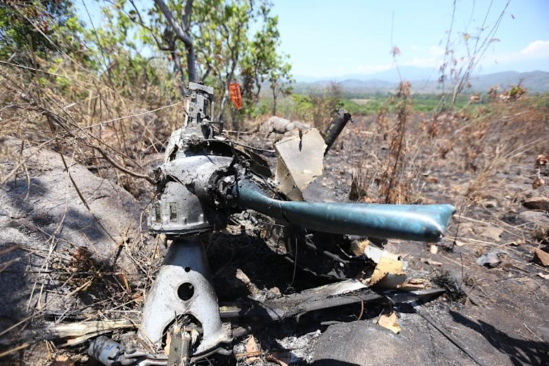 Remains of a Mexican military helicopter believed to have been shot down by members of a drug cartel in Villa Vieja community, Villa Purificacion, Jalisco State, on May 6, 2015