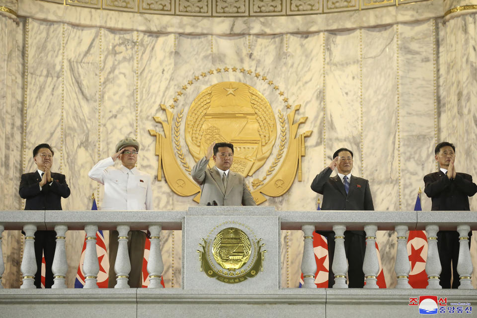"""In this photo provided by the North Korean government, North Korean leader Kim Jong Un, center, waves from a balcony toward the assembled troops and spectators during a celebration of the nation's 73rd anniversary at Kim Il Sung Square in Pyongyang, North Korea, early Thursday, Sept. 9, 2021. Independent journalists were not given access to cover the event depicted in this image distributed by the North Korean government. The content of this image is as provided and cannot be independently verified. Korean language watermark on image as provided by source reads: """"KCNA"""" which is the abbreviation for Korean Central News Agency. (Korean Central News Agency/Korea News Service via AP)"""