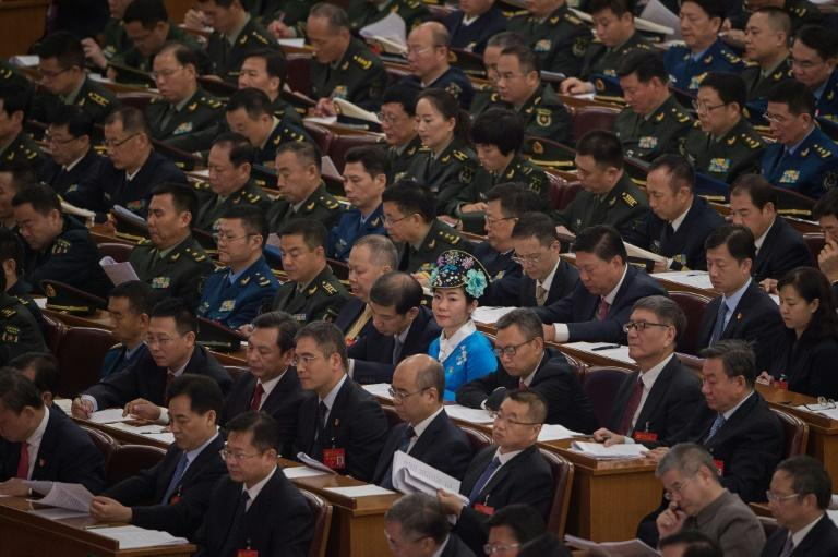 The majority male audience of nearly 2,300 delegates interrupted their collective page-turning to applaud key sections of President Xi Jinping's speech at the 19th Communist Party Congress in Beijing on October 18, 2017