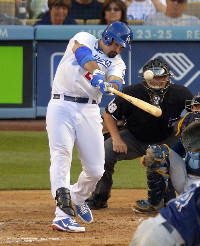 Los Angeles Dodgers' Adrian Gonzalez hits an RBI double during the fourth inning of their baseball game against the Tampa Bay Rays, Sunday, Aug. 11, 2013, in Los Angeles. (AP Photo/Mark J. Terrill)