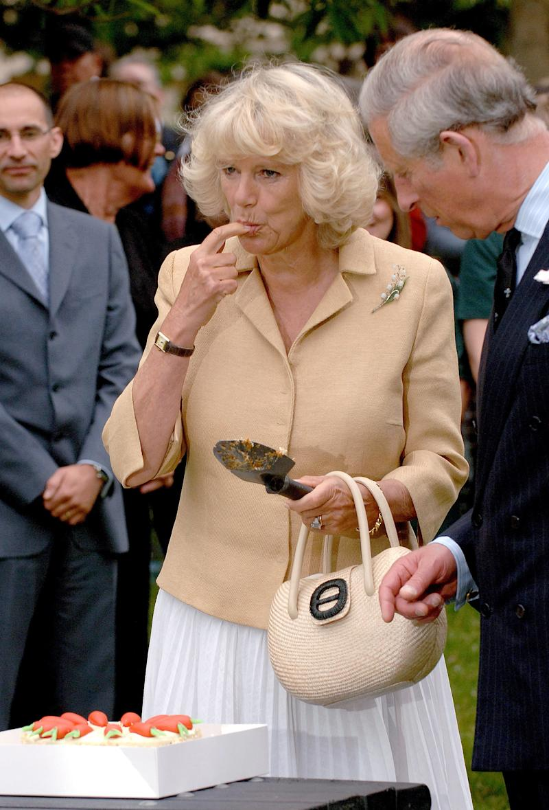 "Camilla Parker Bowles trying some of her 61st birthday cake during her visit to the ""Dig for Victory"" organic allotment in St James's Park in London, July 2008."