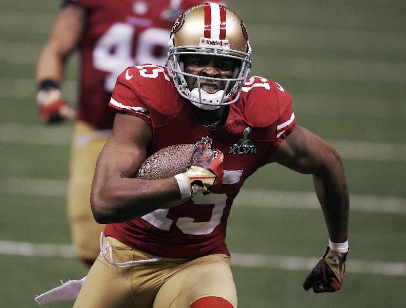 San Francisco 49ers wide receiver Michael Crabtree (15) scores on a 31-yard touchdown reception against the Baltimore Ravens during the second half of the NFL Super Bowl XLVII football game, Sunday, Feb. 3, 2013, in New Orleans. (AP Photo/Bill Haber)