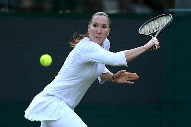 LONDON, ENGLAND - JUNE 26: Jelena Jankovic of Serbia plays a backhand against Vesna Dolonc of Serbia during their Ladies' Singles second round match on day three of the Wimbledon Lawn Tennis Championships at the All England Lawn Tennis and Croquet Club on June 26, 2013 in London, England. (Photo by Clive Brunskill/Getty Images)