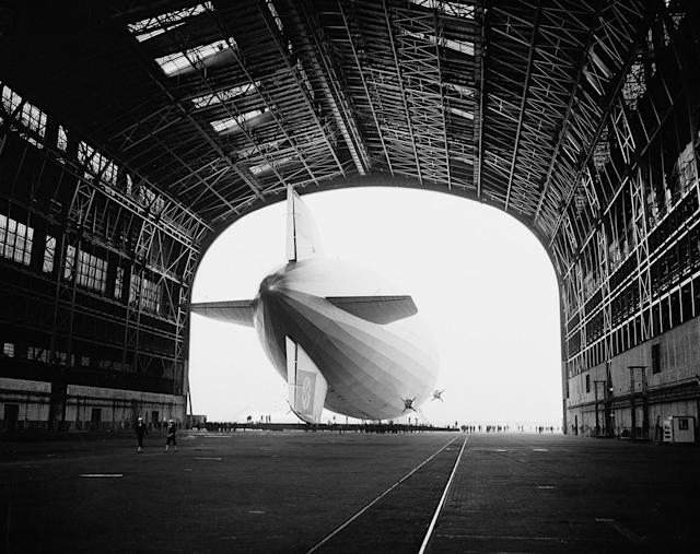 <p>The German-built zeppelin Hindenburg is shown from behind, with the Swastika symbol on its tail wing, as the dirigible is partially enclosed by its hangar at the U.S. Navy Air Station in Lakehurst, N.J., May 9, 1936. (AP Photo) </p>