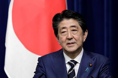 FILE PHOTO: Shinzo Abe, Japan's prime minister, speaks during a joint news conference with Narendra Modi, India's prime minister, not pictured, at Abe's official residence in Tokyo, Japan October 29, 2018.  Kiyoshi Ota/Pool via Reuters