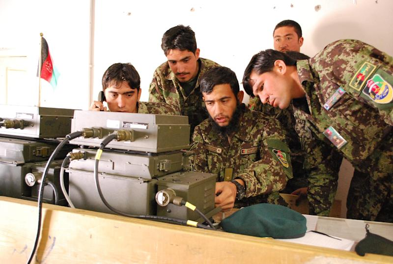 In a Saturday, May 18, 2013 photo, Afghan National Army soldiers from the 2nd Kandak, 4th Brigade, 201st Corps in the Shinwar district of Nangarhar Province, Afghanistan, train on their radio. U.S. Army advisers are working to support the Afghan military as they take control of security ahead of the 2014 drawdown of U.S. forces. (AP Photo/Kristin M. Hall)