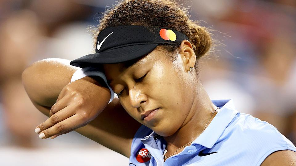 Pictured here, Naomi Osaka looks upset during her Cincinnati Masters round of 16 defeat.