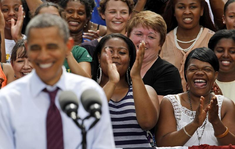 President Barack Obama smiles as supporters applaud during a rally at Norfolk State University in Norfolk, Va., Tuesday, Sept. 4, 2012. ( AP Photo/Steve Helber)