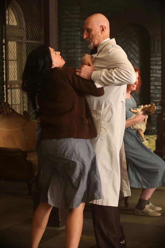 "Franka Potente as Kassie and James Cromwell as Dr. Arden in the ""American Horror Story: Asylum"" episode, ""I Am Anne Frank, Pt. 1."""