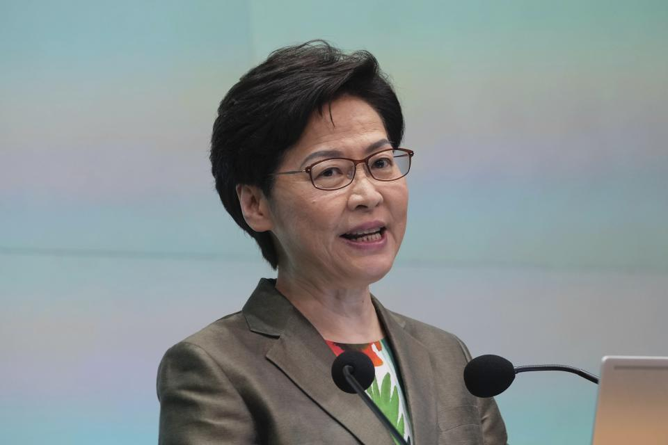 Hong Kong Chief Executive Carrie Lam speaks during a news conference after delivering her policy address at the Legislative Council in Hong Kong, Wednesday, Oct. 6, 2021. Lam announced a major development plan Wednesday, for Hong Kong's border area with mainland China in the last annual policy address of her current term. (AP Photo/Kin Cheung)