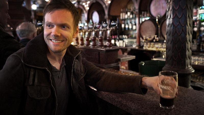 "This publicity image released by Esquire Network shows host Joel McHale at a pub in Belfast, Ireland, in a scene from the series ""The Getaway."" NBC Universal on Wednesday announced the rebranded Esquire Network. The channel is the namesake of Esquire magazine and is aiming to draw a similar audience of upscale males. NBCUniversal and Hearst Magazines are the partners behind the Esquire Network, which is a NBCUniversal Cable Entertainment unit.  (AP Photo/Esquire Network)"