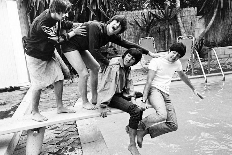 <p>The Beatles clown around in the pool at their Hollywood Hills hideout during their first U.S. and Canada tour in 1964.</p>