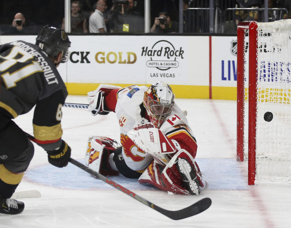 Vegas Golden Knights center Jonathan Marchessault (81) shoots on Calgary Flames goaltender David Rittich (33) during the second period of an NHL hockey game Saturday, Oct. 12, 2019, in Las Vegas. (AP Photo/Benjamin Hager)