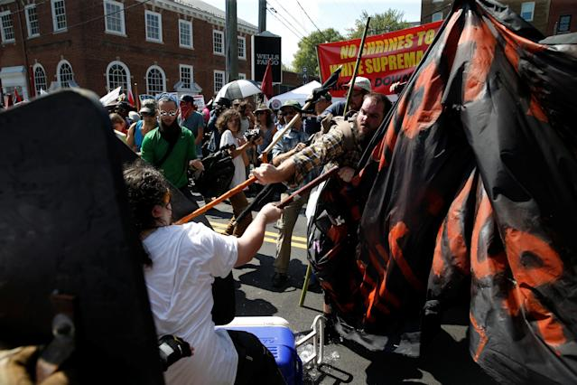 <p>Members of white nationalists clash a group of counter-protesters in Charlottesville, Va., on Aug. 12, 2017. (Photo: Joshua Roberts/Reuters) </p>