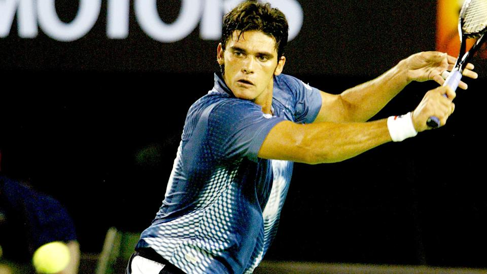 Mark Philippoussis, pictured here in action against Thomas Johansson at the Australian Open in 2004.