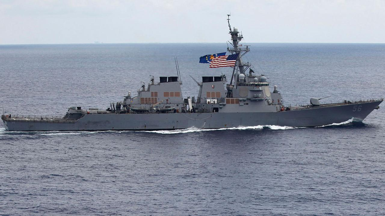 Five sailors were injured and 10 others were missing after a U.S. Navy guided-missile destroyer collided with a merchant ship in waters east of Singapore, the Pentagon said.