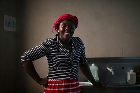 Haitian migrant, Naomi Josil, 29, poses for a photo inside the kitchen of the Juventud 2000 shelter after leaving Brazil, where she relocated to after Haiti's 2010 earthquake, in Tijuana, Mexico, October 7, 2016. Picture taken October 7, 2016. REUTERS/Edgard Garrido