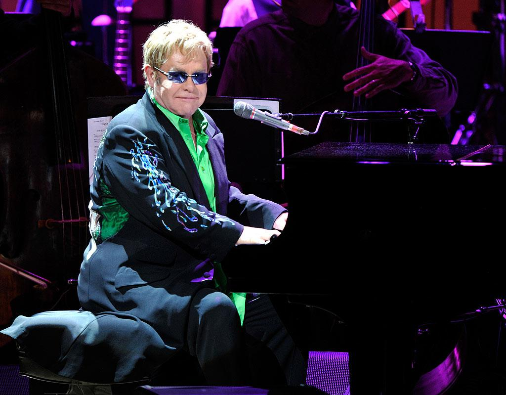 "Music legend Elton John told <i>Parade</i> magazine he and his partner of 17 years, David Furnish, whom he married in 2005, keep the spark in their relationship alive by exchanging cards every Saturday, ""no matter where we are in the world, to say how much we love each other."" Kevin Mazur/<a href=""http://www.wireimage.com"" target=""new"">WireImage.com</a> - May 13, 2010"
