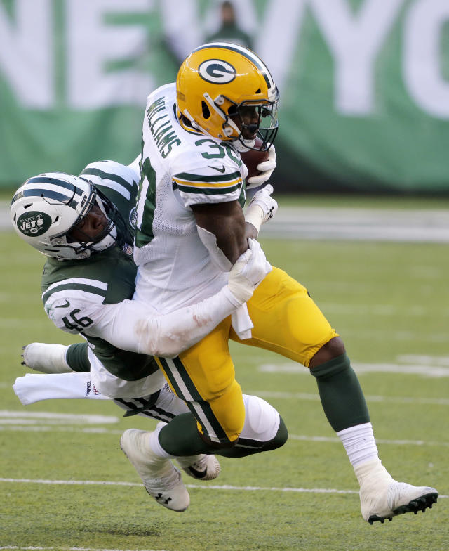 Green Bay Packers running back Jamaal Williams, right, is tackled by New York Jets linebacker Neville Hewitt during the second half of an NFL football game, Sunday, Dec. 23, 2018, in East Rutherford, N.J. (AP Photo/Seth Wenig)