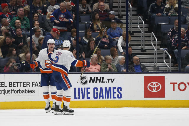 New York Islanders' Brock Nelson, left, celebrates his game-winning goal against the Columbus Blue Jackets with teammate Nick Leddy during the overtime period of an NHL hockey game Saturday, Oct. 19, 2019, in Columbus, Ohio. The Islanders beat the Blue Jackets 3-2 in overtime. (AP Photo/Jay LaPrete)