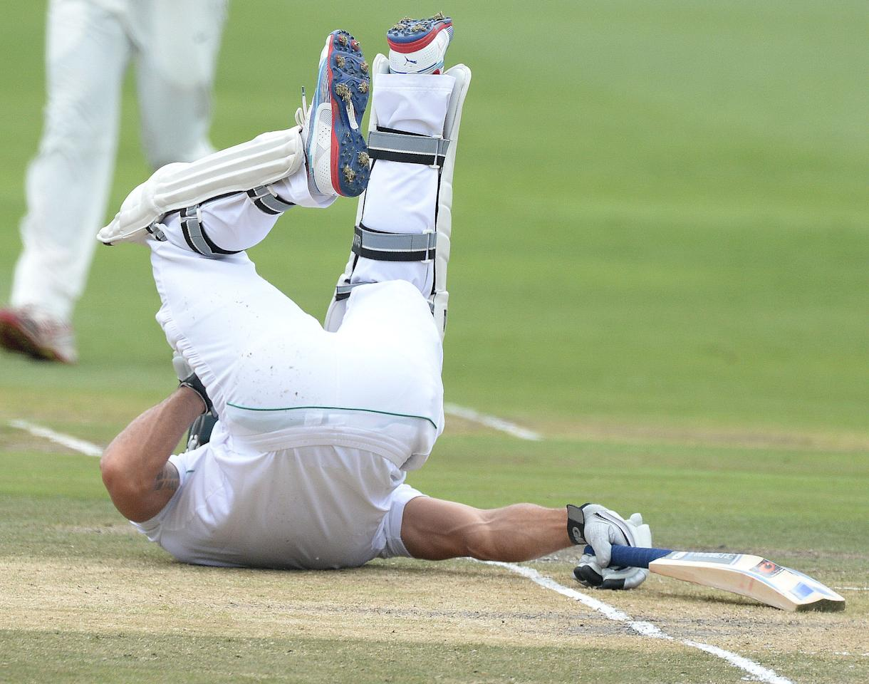 JOHANNESBURG, SOUTH AFRICA - DECEMBER 20: Faf du Plessis of South Africa gets hit in the groin during day 3 of the 1st Test match between South Africa and India at Bidvest Wanderers Stadium on December 20, 2013 in Johannesburg, South Africa. (Photo by Duif du Toit/Gallo Images)