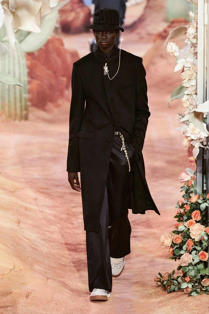 <p>Monsieur Christian Dior liked art. He also liked partnerships. So to continue the maison's traditions, incumbent men's creative director Kim Jones likes to do the same, collaborating with an artist for each collection. </p><p>His latest collaborated is perhaps the most culturally significant thus far. For under a banner of Cactus Jack Dior, Jones found a natural teammate in 29-year-old rapper Travis Scott. The man is huge. And the resultant show was equally as impressive with lots of oversized LSD cacti (of course), skinny fits, monogrammed knits, the occasional flare and tailoring so relaxed it was almost horizontal. Mr Dior would be proud.</p><p><strong>MC</strong></p>
