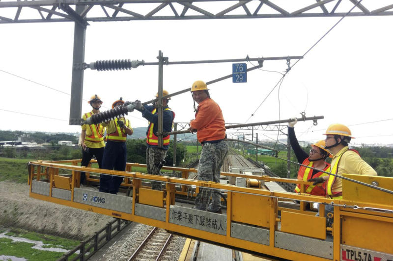 In this photo released by Taiwan Railways Administrations, workers repair damaged facilities for the railway line near Hualien in eastern Taiwan Thursday, April 18, 2019. A strong earthquake rattled eastern Taiwan early Thursday afternoon, causing scattered light damage in the capital and the eastern coast region. (Taiwan Railways Administrations via AP)