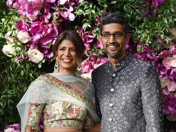 Google CEO Sundar Pichai with his wife and engineer Anjali Pichai as they arrive to attend the wedding ceremony of Akash Ambani, son of Indian businessman Mukesh Ambani, in Mumbai on March 9, 2019.