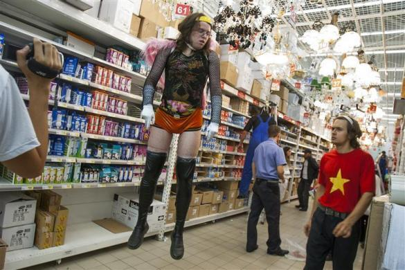 Policical activist Pyotr Verzilov (R) supervises a stunt, the mock execution of a migrant worker and a gay man, in a Moscow megastore, September 7, 2008. Verzilov is the husband of Pussy Riot member Nadezhda Tolokonnikova.