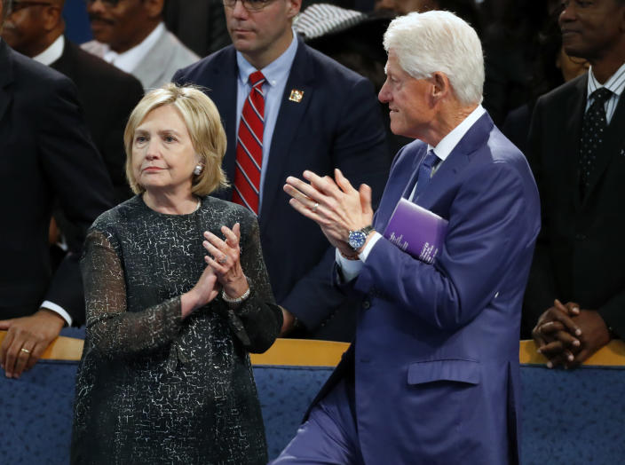 Former President Bill Clinton and wife Hillary Clinton, left, applaud during the funeral service for Aretha Franklin at Greater Grace Temple, Friday, Aug. 31, 2018, in Detroit. Franklin died Aug. 16, 2018 of pancreatic cancer at the age of 76. (AP Photo/Paul Sancya)