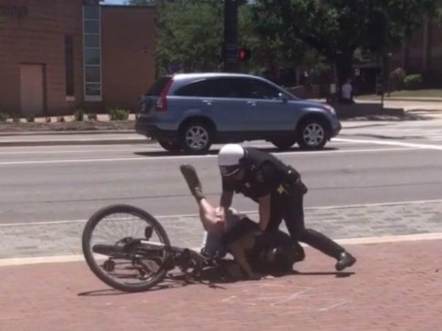 <p>Footage showing College Station Police Department officers tackle a cyclist, who was tasered </p> (Reddit/u/Thep_Erson)