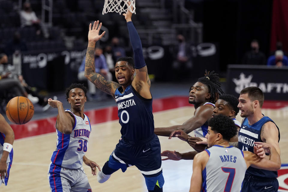 Minnesota Timberwolves guard D'Angelo Russell (0) loses control of the ball during the first half of an NBA basketball game against the Detroit Pistons, Tuesday, May 11, 2021, in Detroit. (AP Photo/Carlos Osorio)