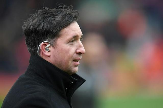 Former Liverpool striker Robbie Fowler, now coach for Brisbane Roar, steered his team to a 1-1 draw away to Perth Glory (AFP Photo/Paul ELLIS)