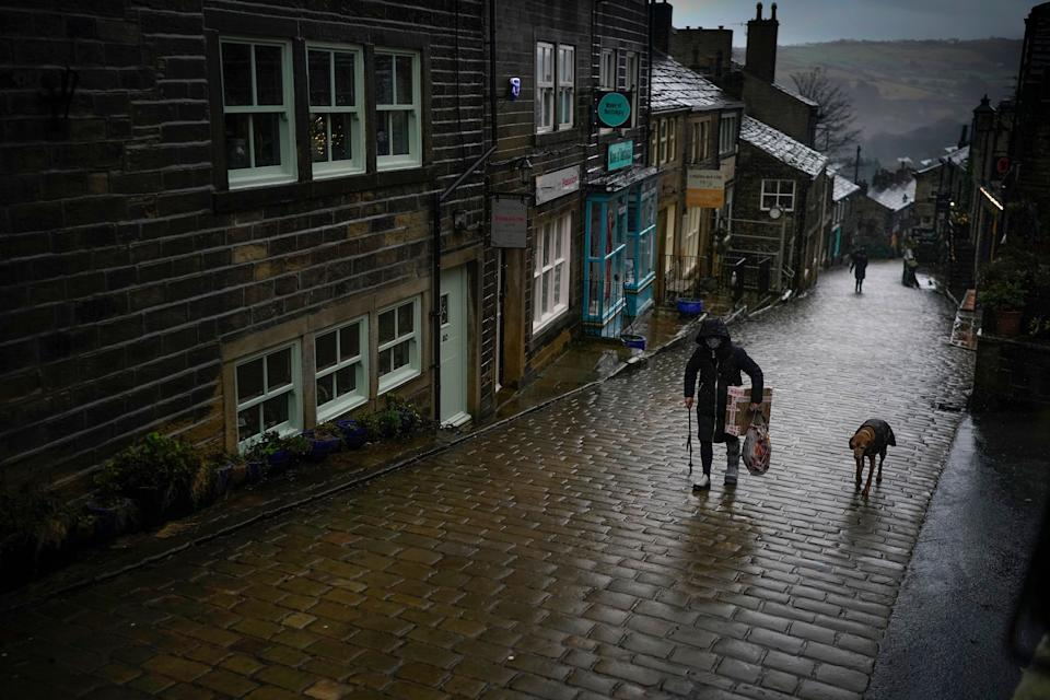 The rain of Storm Christoph and the national pandemic lockdown creates a near deserted Main Street near the Bronte Museum in Haworth (Photo: Christopher Furlong via Getty Images)