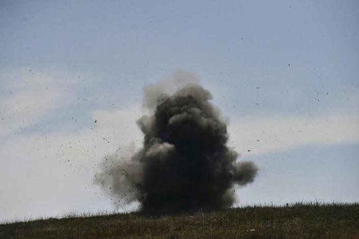 A controlled explosion of unexploded cluster bombs collected by Karabakh sappers