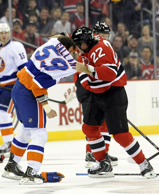 New York Islanders' Brett Gallant, left, fights with New Jersey Devils' Krys Barch during the first period of a preseason NHL hockey game, Thursday, Sept. 19, 2013, in Newark, N.J. (AP Photo/Bill Kostroun)
