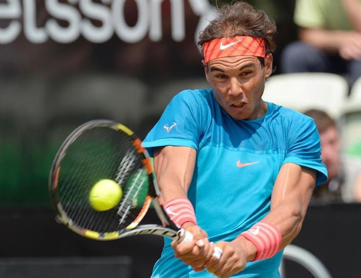 Spain's Rafael Nadal returns the ball to Australia's Bernard Tomic during their quarter-final at the Stuttgart Open in southern Germany, on June 12, 2015 (AFP Photo/Thomas Kienzle)