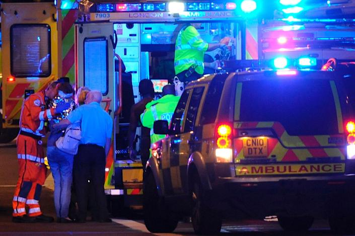 <p>Members of the emergency services attend to persons injured in an apparent terror attack on London Bridge in central London on June 3, 2017.<br> Armed police fired shots after reports of stabbings and a van hitting pedestrians on London Bridge on Saturday in an incident reminiscent of a terror attack in March just days ahead of a general election. (Daniel Sorabji/AFP/Getty Images) </p>