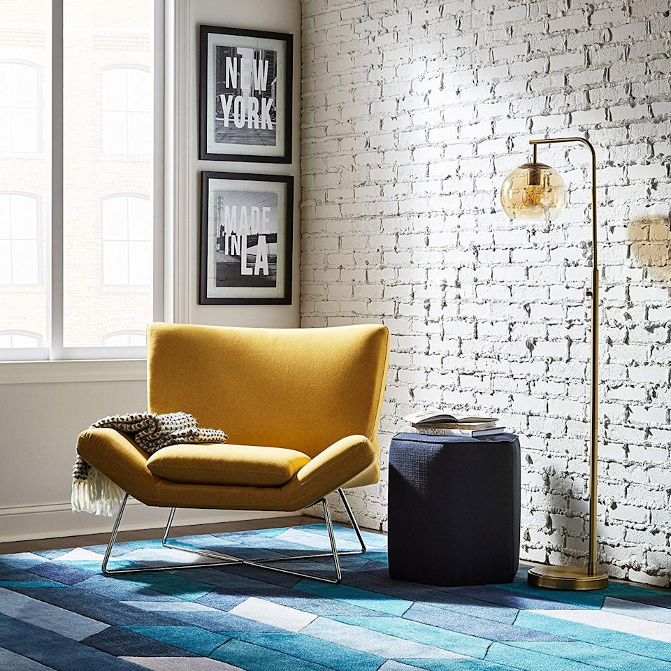 """<h3><a href=""""https://amzn.to/34doWes"""" rel=""""nofollow noopener"""" target=""""_blank"""" data-ylk=""""slk:Rivet Farr Lotus Accent Chair"""" class=""""link rapid-noclick-resp"""">Rivet Farr Lotus Accent Chair</a></h3> <br>If your space lacks room for an actual sofa, opt for an open-framed accent chair instead — reviewers say this plush, blue-velvet armchair is """"large and comfortable"""" with fabric that feels """"soft, but seems durable.""""<br><br><strong>Rivet</strong> Farr Lotus Accent Chair, Canary, $, available at <a href=""""https://amzn.to/2PTMP5w"""" rel=""""nofollow noopener"""" target=""""_blank"""" data-ylk=""""slk:Amazon"""" class=""""link rapid-noclick-resp"""">Amazon</a>"""