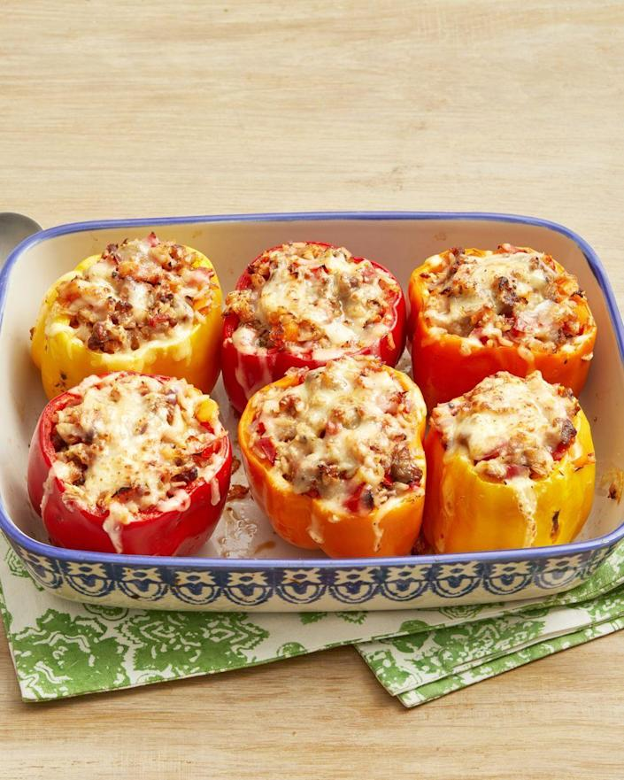 """<p>Get a load of these <em>gorgeous</em> stuffed peppers! Besides being insanely flavorful, you can also make them ahead of time and pop them in the oven when you want. </p><p><strong><a href=""""https://www.thepioneerwoman.com/food-cooking/recipes/a32493093/sausage-and-rice-stuffed-peppers-recipe/"""" rel=""""nofollow noopener"""" target=""""_blank"""" data-ylk=""""slk:Get the recipe."""" class=""""link rapid-noclick-resp"""">Get the recipe.</a></strong> </p>"""