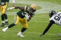 Green Bay Packers' Jamaal Williams runs during the first half of an NFL football game against the Jacksonville Jaguars Sunday, Nov. 15, 2020, in Green Bay, Wis. (AP Photo/Morry Gash)