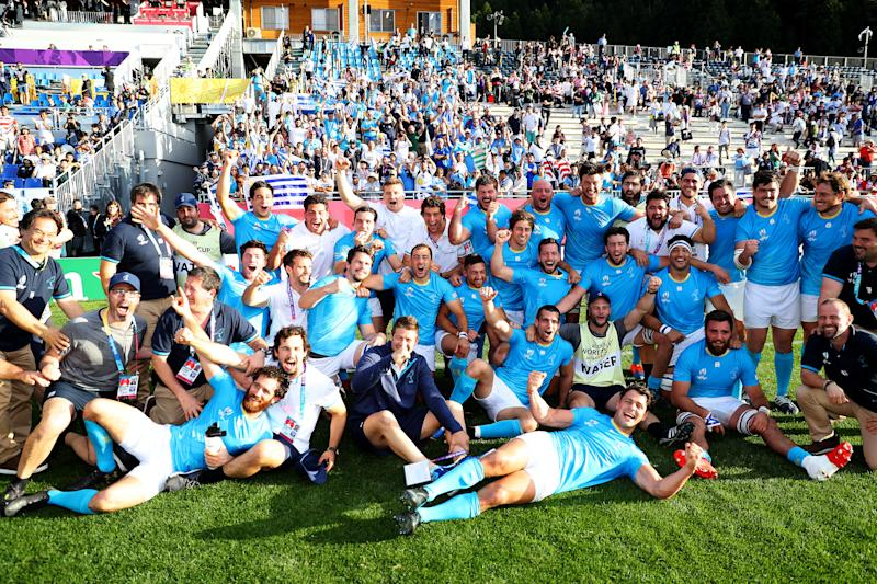 KAMAISHI, JAPAN - SEPTEMBER 25: Uruguay players and staffs celebrate after the Rugby World Cup 2019 Group D game between Fiji and Uruguay at Kamaishi Recovery Memorial Stadium on September 25, 2019 in Kamaishi, Iwate, Japan. (Photo by Warren Little - World Rugby/World Rugby via Getty Images)