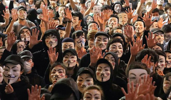"""Protesters announced on online forum LIHKG that they would gather in Tsim Sha Tsui for a """"V for Vendetta rally"""" to protest against the mask ban. Photo: Felix Wong"""